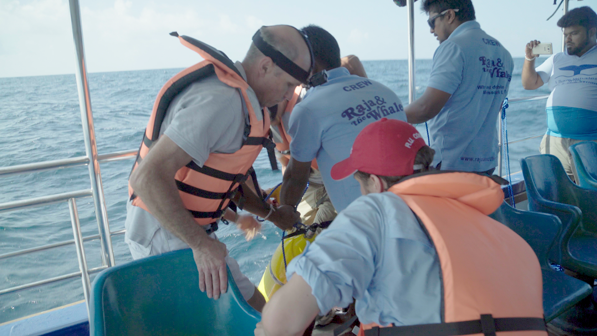 RU29 is lifted aboard a Sri Lankan whale watching vessel by a team from the Sri Lanka, Australia, and the U.S.